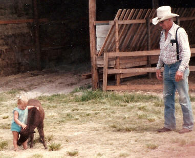 Chuck and granddaughter Torrie with miniature horse foal in 1979